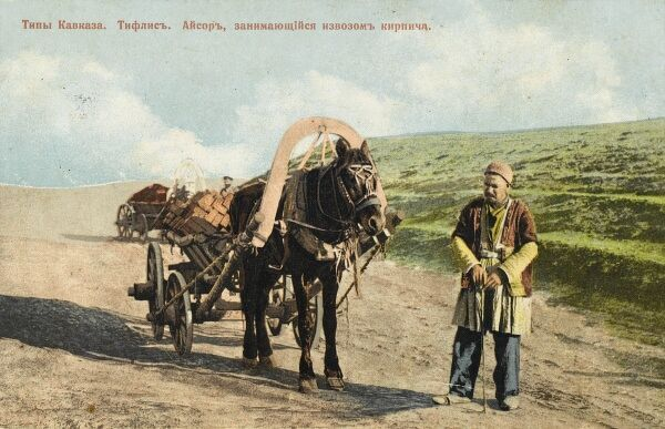 An Azerbaijani builders merchant with his horse-drawn wagon filled with red bricks