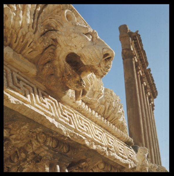 The head of a lion and the six columns of the GREAT TEMPLE of JUPITER built by the Romans On the site of the ancient archaeological city of Baalbek once called Heliopolis