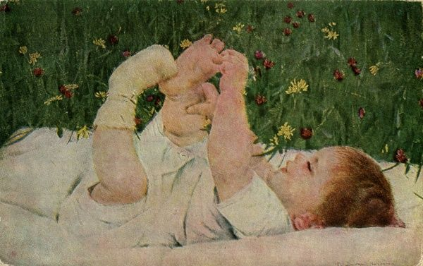 A baby lying on the lawn discovers his toes for the first time. Date: circa 1905
