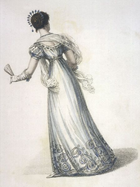 Ball dress possibly of a white transparent fabric worn over a blue slip with deep embroidery on the hem, sleeves & neckline. Note the hair accessories (comb ?)