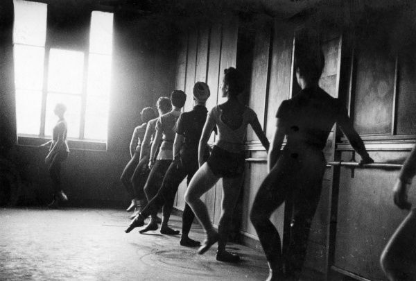 A group of ballet dancers training in a rehearsal studio.  circa 1940s