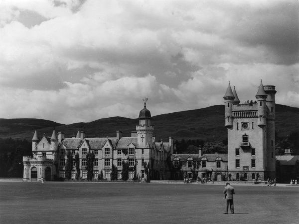 An exterior view of Balmoral Castle, Aberdeenshire. Built in 1854 of light Scotch granite. The clock tower is 100 ft high. Date: 1950s