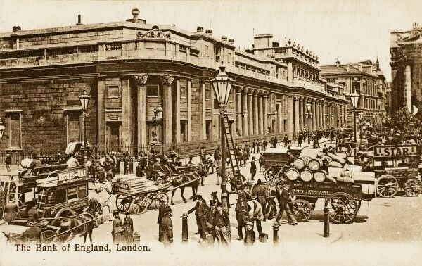 The Bank of England, London with much traffic in the foreground in the form of horse buses, wagons and carts and many pedestrians. A lamp is being attended to by a worker with a long ladder in the foreground