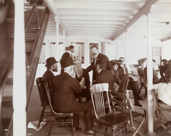 Bankers Conventions, to Westpoint, N.Y., Guests of Charles W. Morse aboard C.W. Morse. Men and women seated on a covered deck of the C.W. Morse at a bankers convention in West