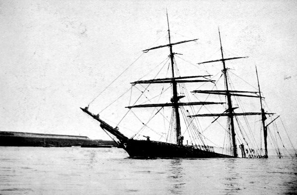Photograph showing the Swedish barque 'Berean' aground off Tilbury, Thames estuary, 1910