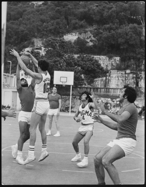 Men in rather skimpy shorts playing basketball in Gibraltar, Spain!