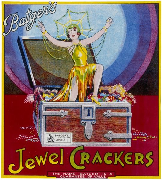 A bright and colourful label for a box of Batgers Jewel Christmas crackers featuring a lady emerging from a casket of jewels. Presumably, the gifts inside this particular batch of crackers are jewellery