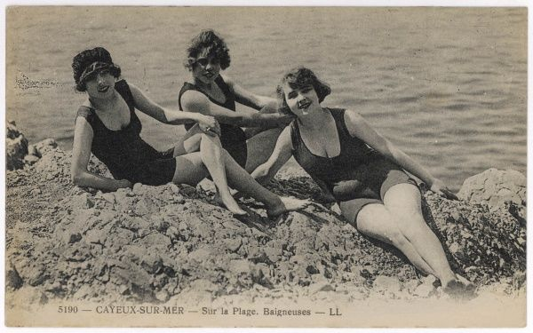 Three bathing beauties relaxing by the sea at Cayeux-sur-Mer, France