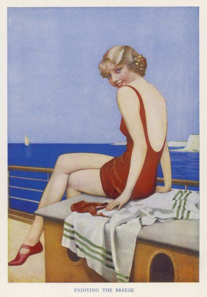 Girl in red bathing costume enjoys the breeze on a boat sailing on very calm water