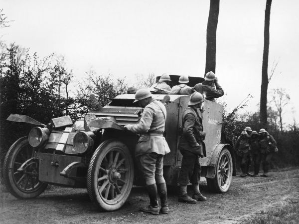 French armoured car supporting British troops from the 18th Middlesex Composite Force, XV Corps, at the Battle of the Lys on the Western Front in Belgium during World War I in April 1918