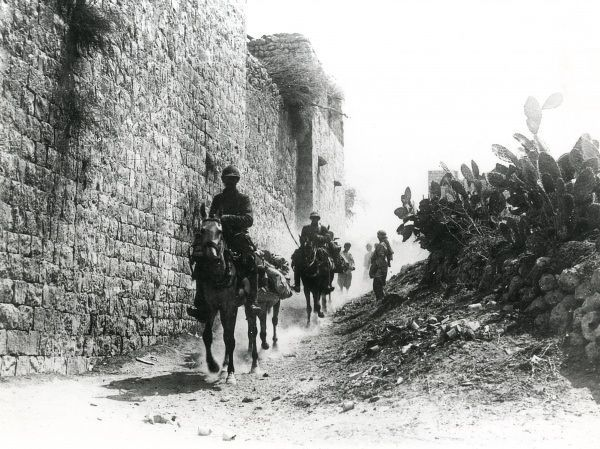 Scene during the Battle of Megiddo, showing men of the 4th Regiment Chasseurs d'Afrique on the outskirts of the village of Anebta, in the Ottoman Empire (now Israel) during the First World War. Date: 1918