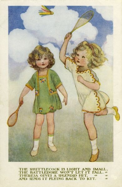 Two little girls play battledore and shuttlecock, or badminton on a fine summer's day