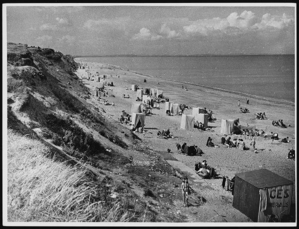 View of the cliffs and beach at Hornsea in Yorkshire - a popular place for changing- tents