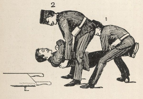 Method of lifting a patient onto a stretcher, with two bearers. (1 of 2)