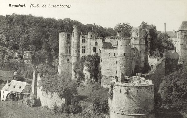 Beaufort - Luxembourg - Castle ruins. The oldest part of the castle dates from the early 11th Century. It was a small square-shaped fortress on a massive rock, surrounded by a wide ditch and a second wall facing the valley. Date: circa 1910s
