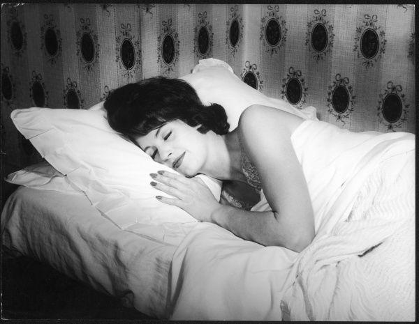 An attractive young woman catches up on her beauty sleep