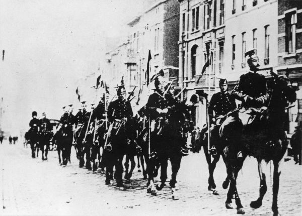 Belgian cavalry riding along a Brussels street, Belgium, at the start of the First World War. Date: August 1914