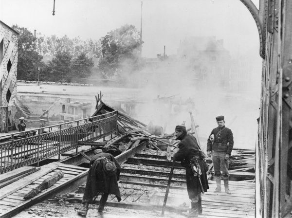Belgian engineers blowing up a railway bridge at Termonde, Belgium, towards the start of the First World War, in order to delay the German advance. Date: 18 September 1914