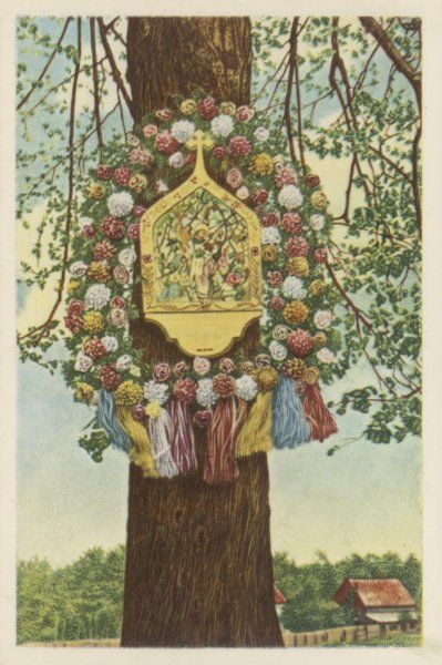 A 'Chapelle de mai' hangs on a tree in the Belgian countryside near Campine, a temporary shrine to celebrate 'Mary's month' - May