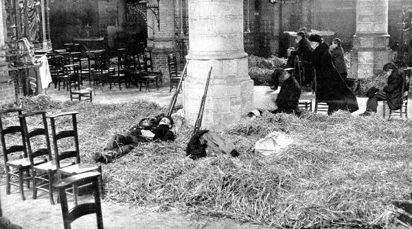 Belgian soldiers sleep in a church while women and civilians pray for their countr's liberation