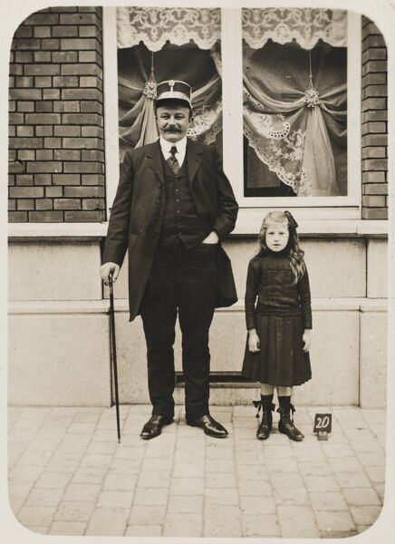 Belgium - Senior Belgian Railway Official & daughter standing in front of his house which boast the most elegant and exotic net curtains one is likely to witness in one's lifetime
