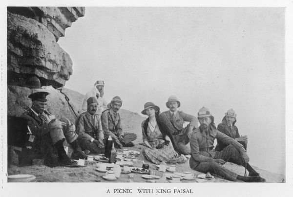 GERTRUDE M L BELL English traveller picnicking with King Faisal of Iraq, (seated, second right) in 1922