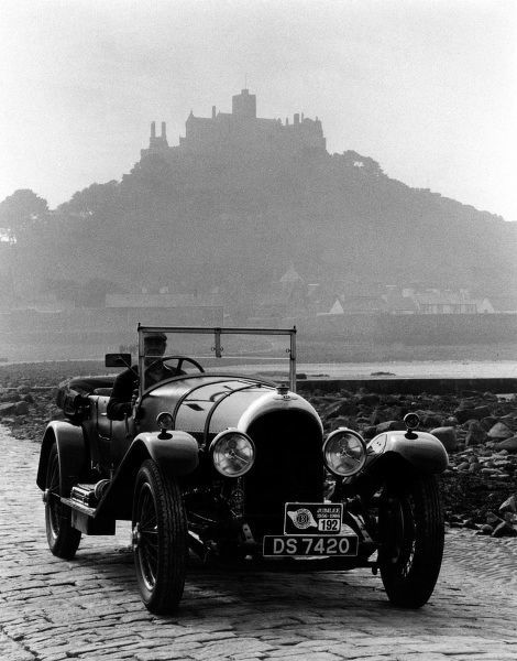 A 4.5 litre Bentley car and its driver with St Michael's Mount in the background. (2 of 2)
