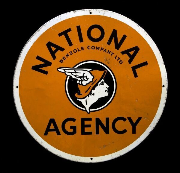 A circular tin/alloy sign advertising 'National Agency' - Benzole Company Ltd. *EDITORIAL USE ONLY*