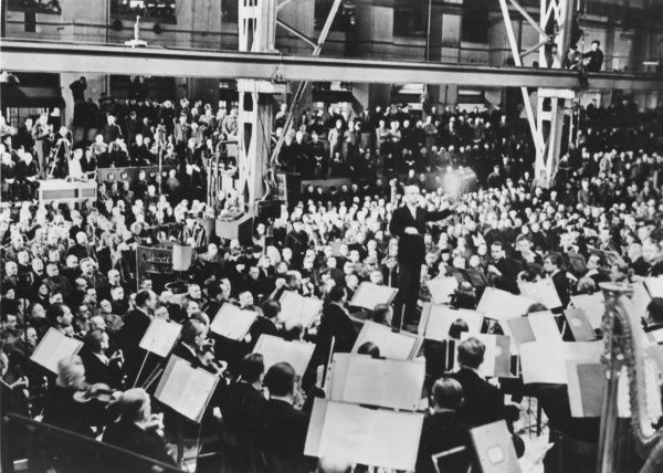 Berlin Philharmonic Orchestra, conducted by Wilhelm Furtwangler, playing a Beethoven concerto during a lunch hour in a German armaments factory in Germany in 1944