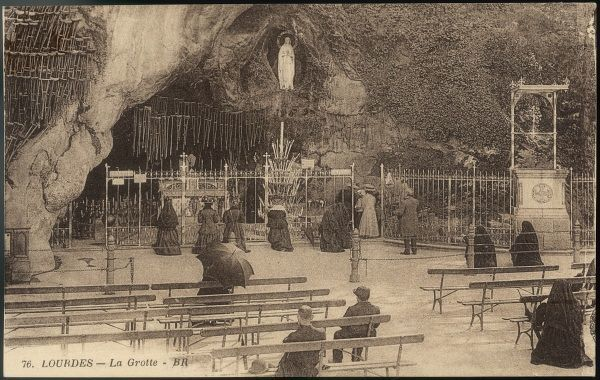 The grotto of Massabielle at the beginning of the 20th century - showing the statue, and crutches left by those who, miraculously, don't need them any more