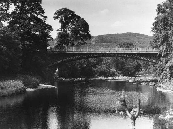 The Waterloo Bridge at Betwys- y-Coed, Caernarvonshire, Wales, was built by Thomas Telford in 1815. 'The arch was constructed in the same year Waterloo was fought'. Date: built 1815