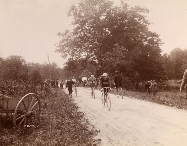 Bicycle Coasting Match, Mamaroneck, N.Y. Bicyclists coasting on a dirt road in Mamaroneck, N.Y