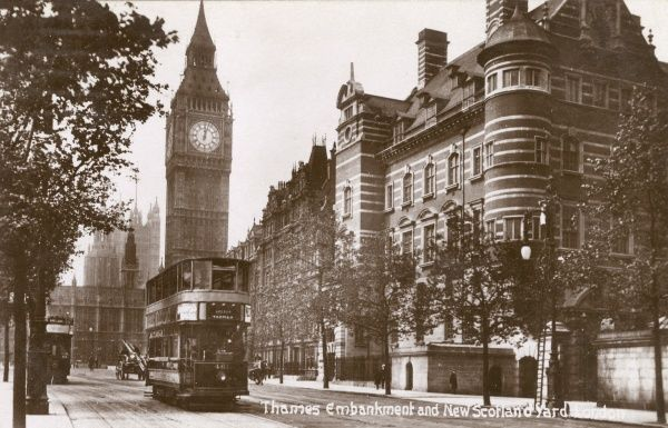 Big Ben and Thames Embankment with a tram and New Scotland Yard in London c. 1909