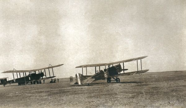 Two biplanes side by side in the desert, somewhere in Iraq
