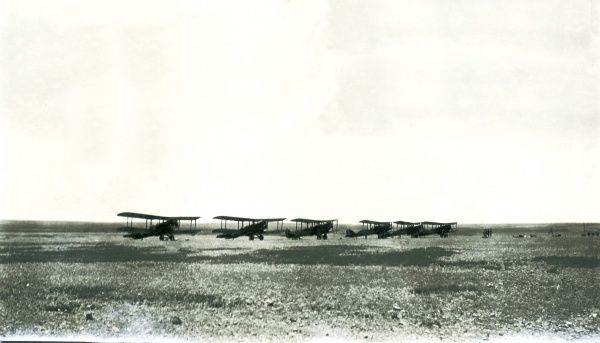 Six biplanes lined up in the desert, somewhere in Iraq