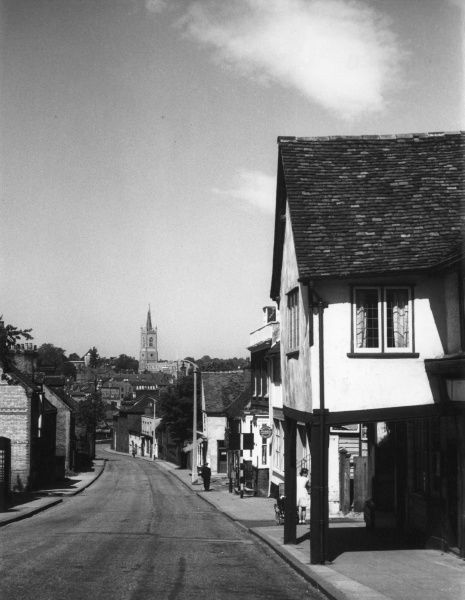 Bishops Stortford, Hertfordshire, England, with its fine old houses and shops and the 15th century church, in the distance. Date: 1960s