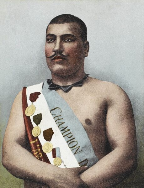 Black Ahmed (Cara Achmed) - a champion wrestler from Constantinople, wearing a champion's sash and bearing the medals of his victories with pride. He sports a very finely clipped moustache and interesting chevron necklace