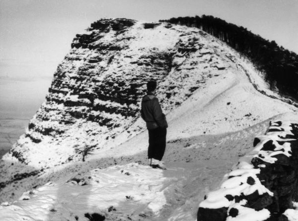 Black Tor, a gritstone eminence above Edale, Derbyshire, after a snowfall. Date: circa 1960