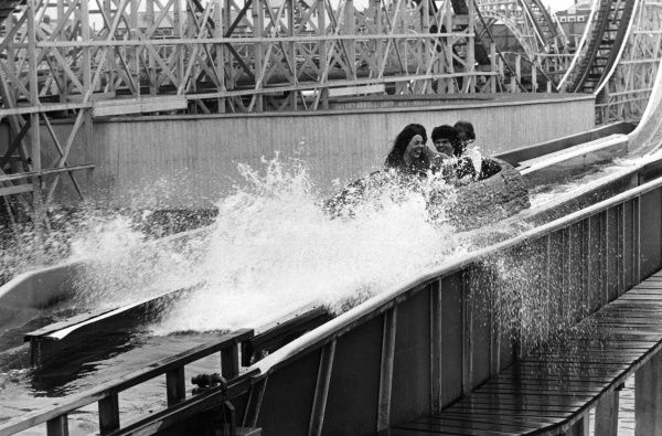These holidaymakers are getting wetter than they bargained for on the Log Flume at the famous 'Pleasure Beach' funfair, Blackpool, Lancashire, England! Date: late 1960s