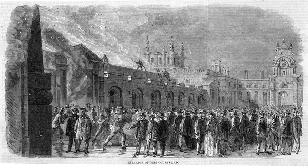 Crowds watch in the courtyard at Blenheim Palace, Oxfordshire, as the firefighters subdue the flames which threaten to destroy the noble pile