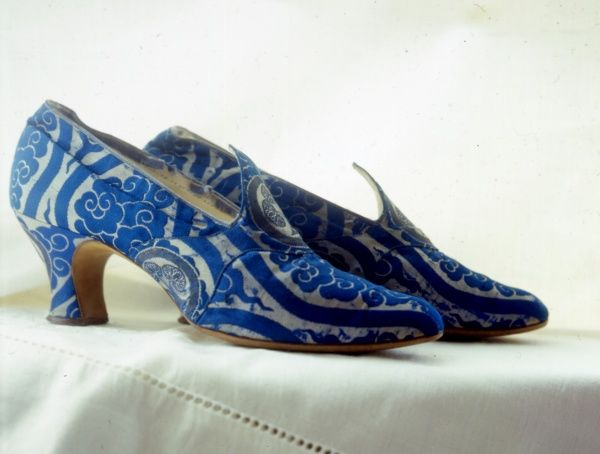A stylish pair of blue and white patterned ladies' court shoes with a short heel, from Harrods, London