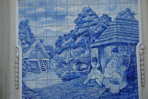 A picture on blue tiles outside the former Ritz Cafe, in the Avenida Arriaga in Funchal, Madeira, Portugal. This type of traditional design, on blue and white tin-glazed ceramic tiles, is known in Spain and Portugal as azulejo or azulejos