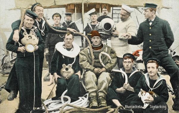 A group of British Naval Divers (Bluejackets) messing about on deck