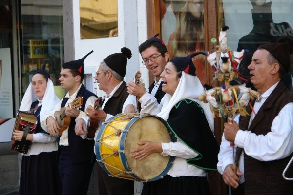 A traditional Boa Nova folk group playing musical instruments and singing, seen in Funchal, the capital city of Madeira. The man on the right is holding a percussion instrument known as a brinquinho, a stick decorated with wooden dolls, bells and castanets