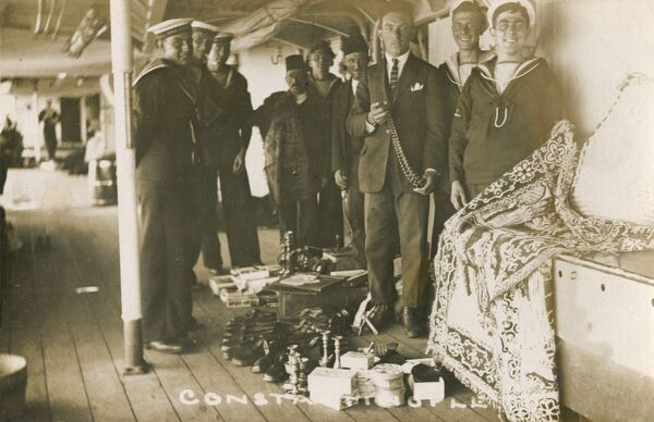 British sailors inspect wares (tourist tat!) bought onboard the British battleship HMS Caesar, in port at Istanbul - searching out that special exotic souvenir to take home to a loved one!