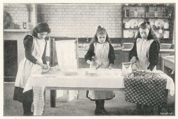 Board school girls receive a domestic education that will prepare them for housewifery. Here they are given a lesson in ironing