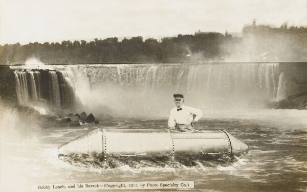 British former stuntman Bobby Leach (1858 - 1926) and his barrel, in which he survived passage over Niagara Falls, Canada, at severe detriment to his future health! He was the second person to go over the falls in a barrel in July, 1911