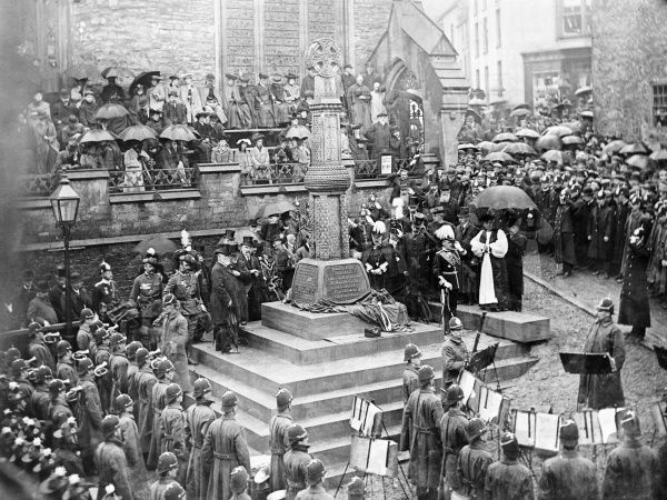 Commemorative photograph of the unveiling of the Boer War Memorial at St Mary the Virgin Church, High Street, Haverfordwest, Pembrokeshire, Dyfed, South Wales. The memorial is surrounded by local dignitaries, clergy, a police band and crowds of townspeople