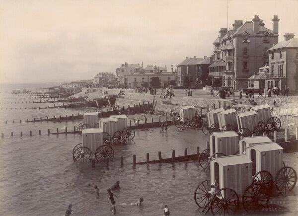 A wonderful photograph by William Pankhurst Marsh of the horse-drawn bathing Wagons at Bognor. The Royal Pier Hotel can be seen