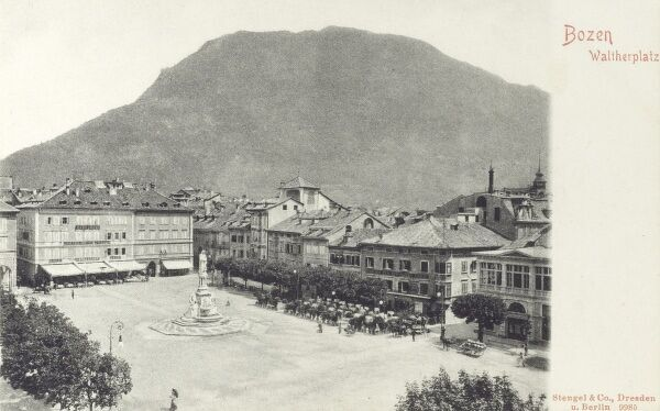 Waltherplatz - Bolzano (or Bozen in German) - a city and comune in the Trentino-Alto Adige/Sudtirol region of Italy in the far north east of the country. This card shows Walther Square, with a statue of Walther von der Vogelweide, a German minstrel